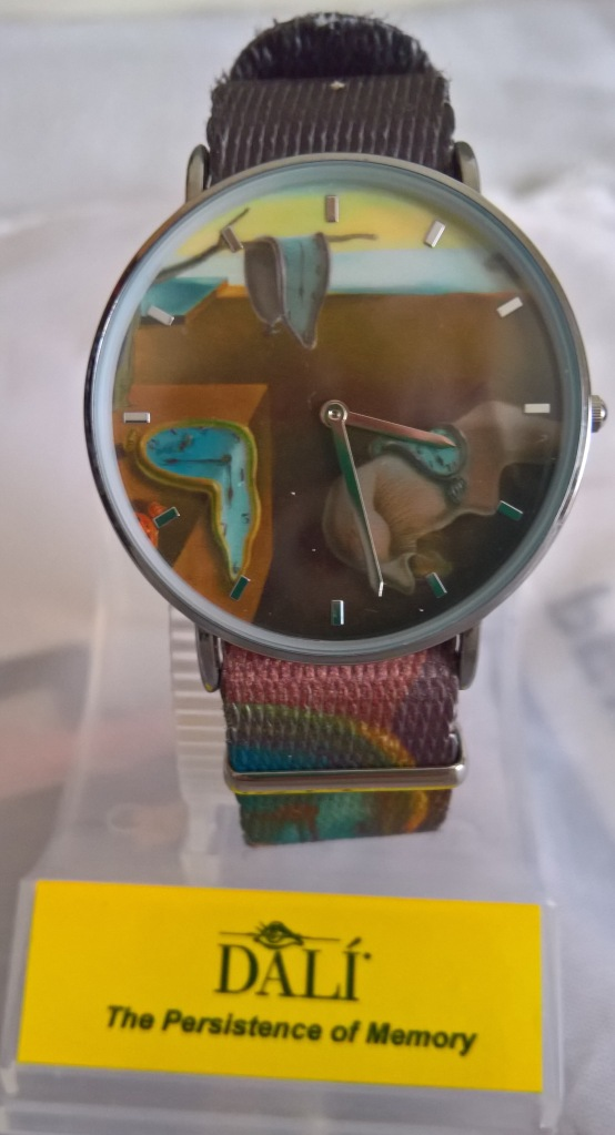 Watch with melting clocks image on face